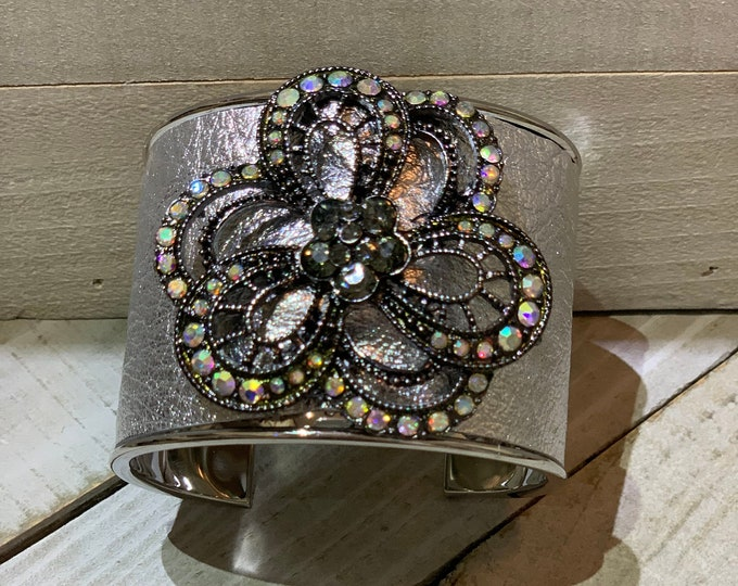 Silver, silver metallic leather & rhinestone gunmetal flower embellishment inlaid cuff bracelet