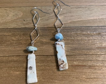 Light blue larimar stones suspended under silver diamond shaped findings, hanging from 925 sterling silver hooks