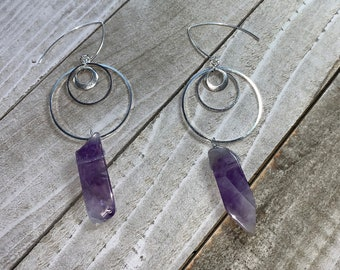 Amethyst tooth bead stone suspended from three graduated silver circles attached to sterling silver earwires
