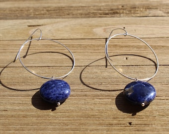 Blue sodalite stone coin, suspended from skinny silver circle and hung from silver 925 sterling silver french hooks