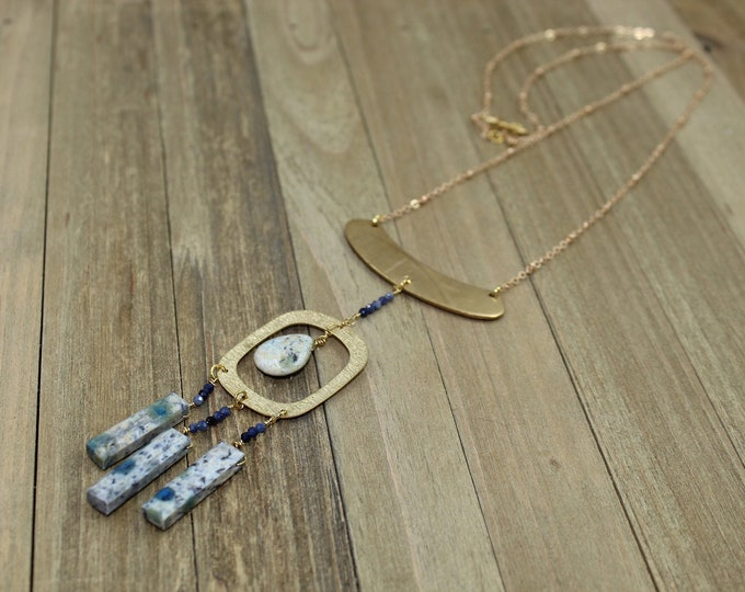 K2 Jasper stick and briolette beads suspended from oval shaped brass on gold colored chain with s hook closure
