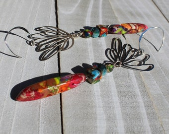 Rainbow sea sediment jasper teardrops hanging from stainless steel lotus geometric shapes, on 925 sterling silver earwires
