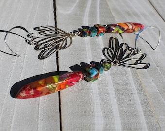 Rainbow sea sediment jasper teardrops hanging from stainless steel lotus geometric shapes, on 925 sterling silver earwires