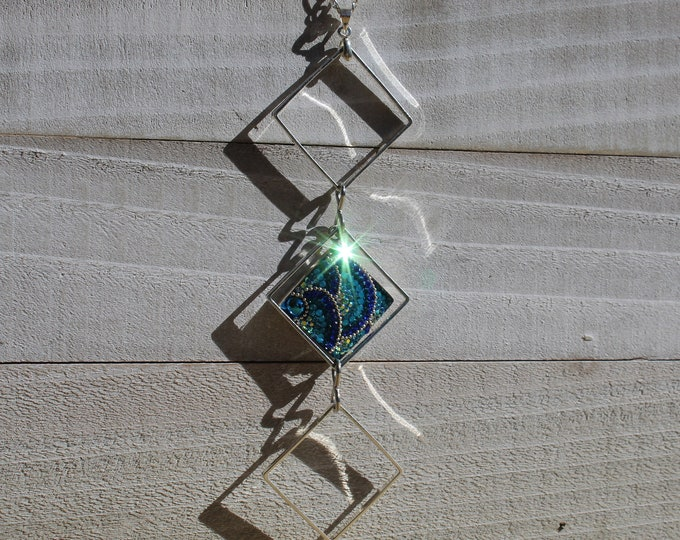 Upcycled funky blue pave rhinestone embedded in 925 sterling silver floating in a silver square on a long silver chain