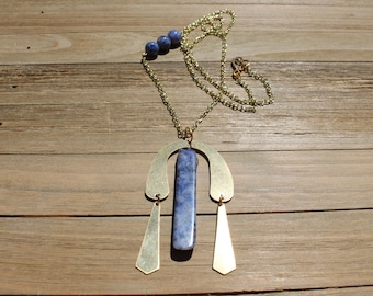 Blueberry sodalite and brass pendant with accent blueberry sodalite attached to a brass chain and closes with s hook