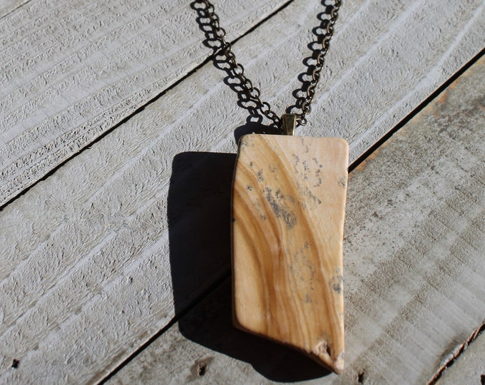 Natural brown picture jasper rectangle slab pendant with antique gold bale on an antique gold toned chain