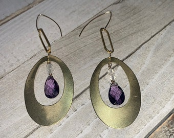 Faceted polished color changing alexandrite suspended inside brass oval shapes with herkimer diamonds on 14k gold filled ear wires