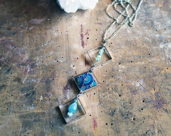 Blue pave rhinestone embedded in 925 sterling silver with aquamarine, rainbow opal, blue beryl in silver squares on a long silver chain