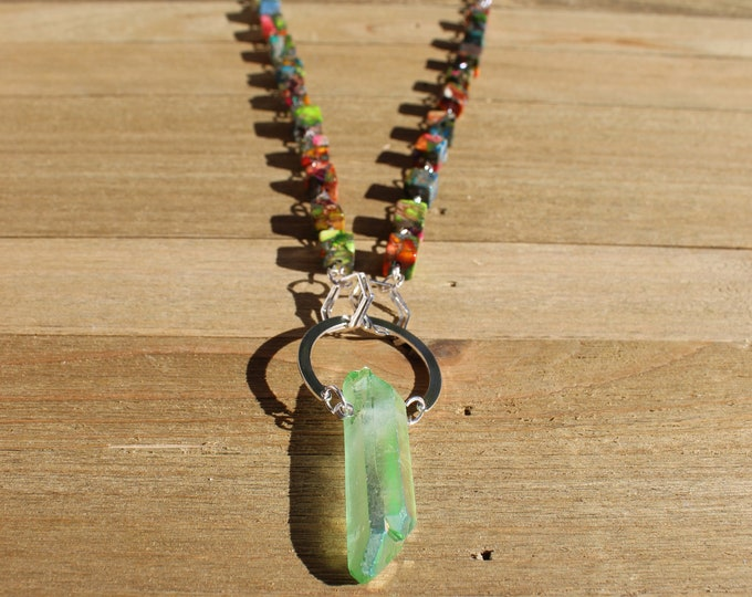 Aura green quartz stick bead suspended under silver semicircle on accented silver chain with rainbow jasper square bead accents