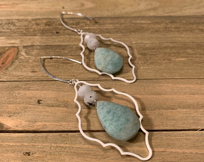 Amazonite and moonstone beads suspended inside a silver freeform geometric shape on sterling silver earwires