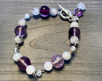 Fluorite, rutilated quartz, white topaz and herkimer diamond rosary beaded bracelet, closes with toggle in silver