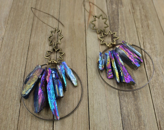 Rainbow electroplated calcite inside antique brass circle, suspended from antique brass star shapes on antique gold nickel free earwires