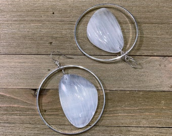 Chunky white selenite stones suspended inside large silver circles on 925 sterling silver ear wires