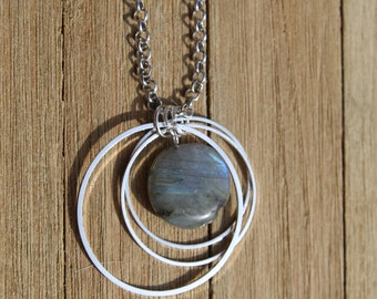 Flashy oval labradorite round pendant floating within three (3) graduated silver circles on a silver chain