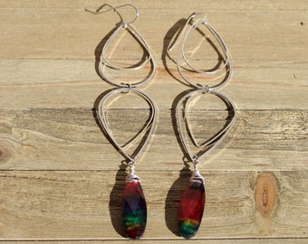 Rainbow abalone shell doublet teardrops hanging from silver teardrop geometric shapes, on 925 sterling silver earwires
