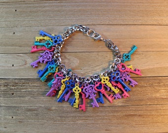 Chunky statement bracelet with multicolored bright enamel metal keys on a shiny silver chain