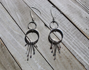 Silver circle long shoulder duster earrings with silver fringe, hanging from 925 sterling silver earwires
