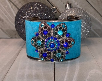 Silver, bright blue suede leather inlaid with rhinestone silver flower embellishment cuff bracelet