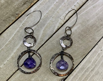 Dyed purple quartz teardrop suspended from multiple gunmetal circles, hanging from nickel free gunmetal earwires