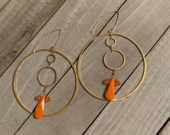 Orange coral teardrops and czech glass beads inside a large brass and small brass circles, fastened to 14k gold filled earwires