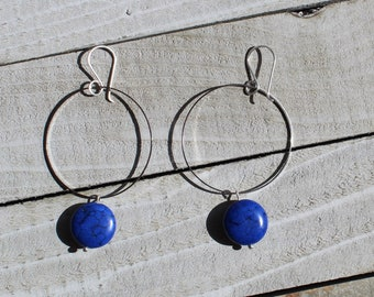 Dyed blue magnesite stone coin, suspended from skinny silver circle and hung from silver 925 sterling silver french hooks