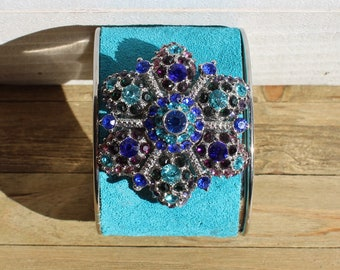 Silver, bright blue suede leather inlaid with rhinestone silver flower embellishment cuff bracelet
