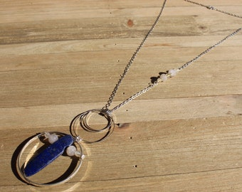 Lapis lazuli and rutile gold quartz floating inside silver circles with rutile quartz beads embedded in silver chain