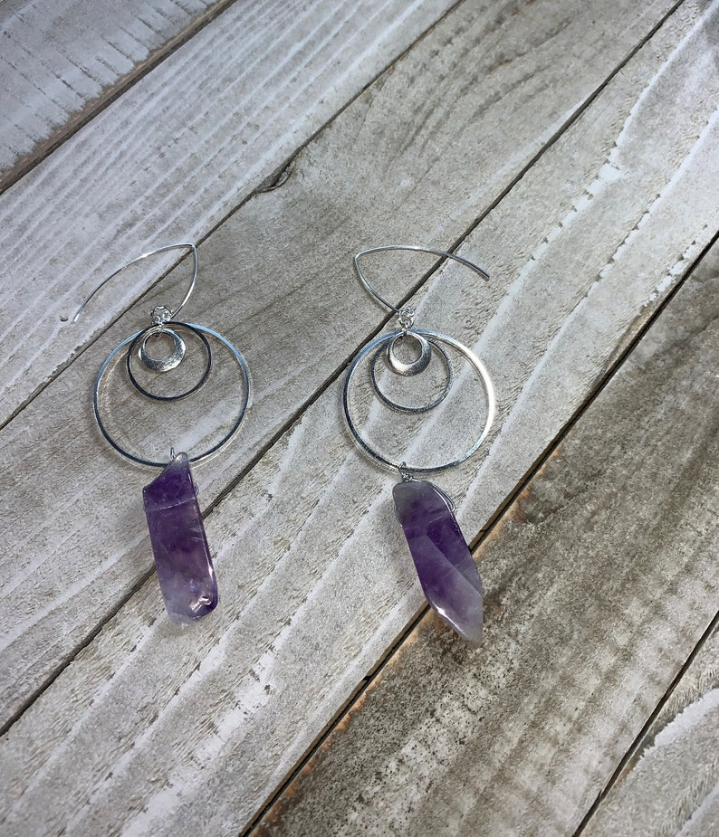 Amethyst tooth bead stone suspended from three graduated image 0