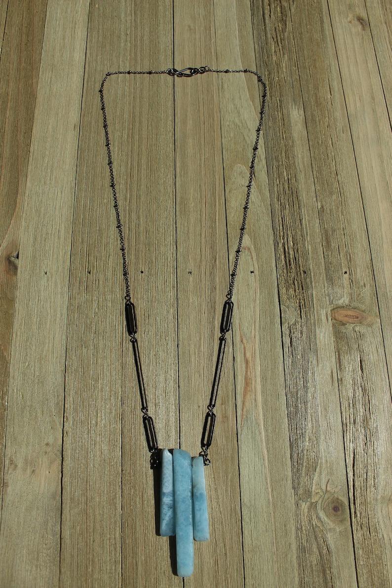 Raw aquamarine stick bead pendant with gunmetal geometric image 0