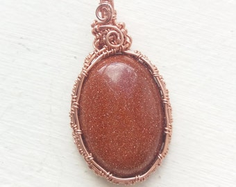 goldstone copper wire cabochon pendant