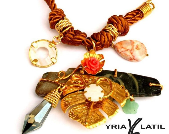 Rope necklace w/ gold plated metal tropical leaf and a unique nature's river stone cut and polished. Also crystals and gemstones