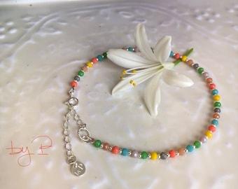 Bracelet de cheville perles en argent et perles multicolores facettées en verre