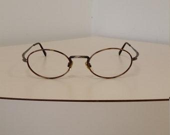 75394793caa8 1990s Giorgio Armani Eyeglasses Frame  Oval Tortoise Front w Gunmetal  Silver Trim  Excellent Condition  Rx-able  Read Description for Size