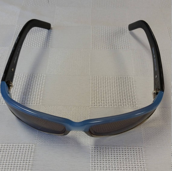1990s Ready to Wear Sunglasses by Jonathan Cate USA Designer; Wrap Style; Frame Model Talon; UVAUVB Protective Lenses; Excellent Condition