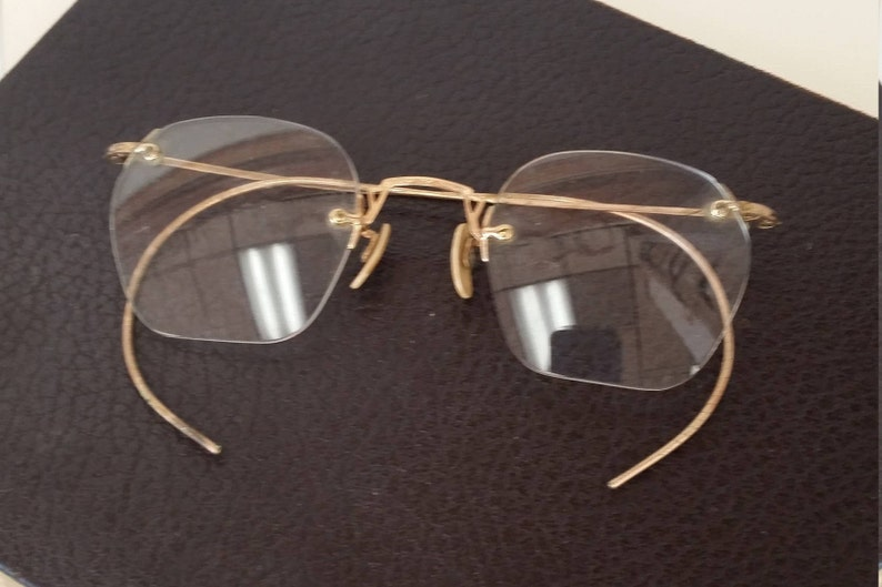 3fd70302a1 1930s American Optical Gold Rimless Eyeglasses Marked 1 10 12