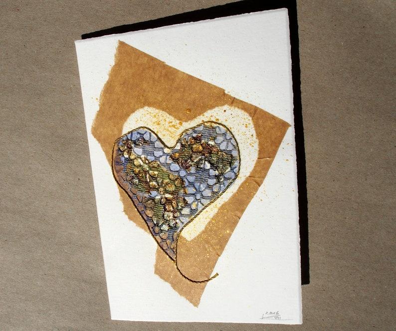 How to Fold a Dollar Bill Into an Origami Heart | HGTV | 665x794