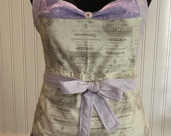 Women's  ruffled full apron Paris theme in lilac lavender cream purple posh girl style vintage button trim ruffle hem shabby chic flower pin