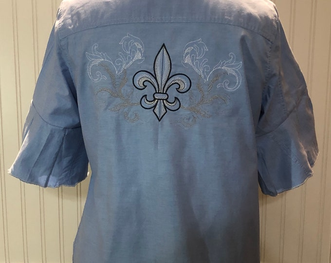 Women XL light blue cotton shirt embroidered fluer de lis back flare sleeves split side tie up sides embroidered sleeves black white stitch