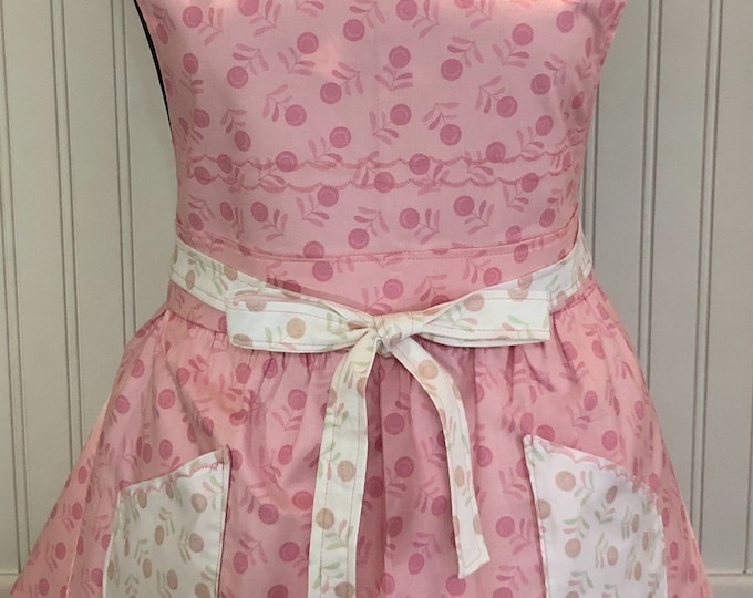 Women's full apron, reversible cherry print, twirl skirt, button accents, pink white cherries, square pockets, square bodice, stitching trim
