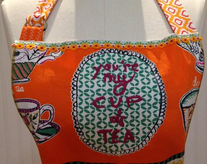 Women's full apron orange yellow tea cups long fabric ties vintage trim repurposed linens Daisy trim bodice towel loop ruffled hem 2 pockets