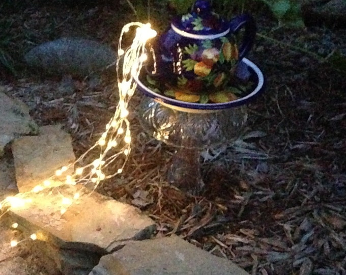 Yard art lighted teapot tower teapot table center piece etched glass repurposed glass blue flowered teapot lighted teapot copper stake