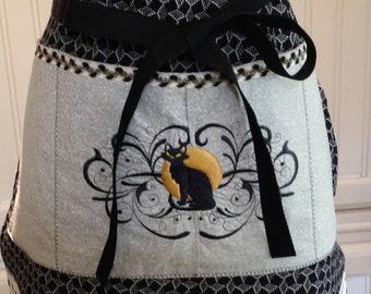 Full Apron Vintage style reversible black print reverses to aqua black print contrasting flounce aqua ties black cat pocket embroidery