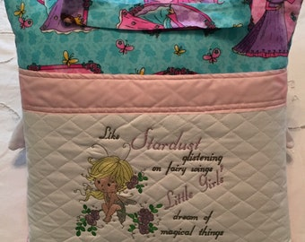 Pocket pillow reading child reading pillow pixie stardust embroidery blue purple princess print fabric zip pink satin trim pink fleece back