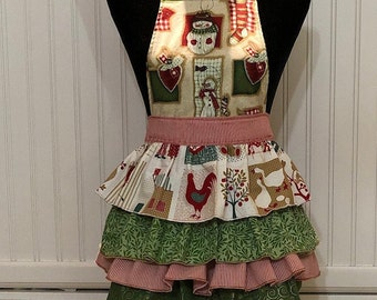 Child's full Christmas apron ruffled tiers snowman green swirl red checked and roosters green grosgrain ribbon ties