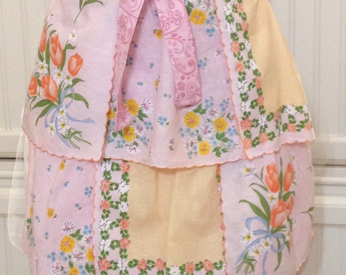 Vintage half apron handkerchief shabby chic pink orange tulips blue bow orange pink flowers pink cotton ties pink hidden pocket pink lined