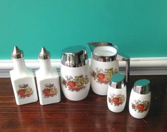 The Spice of Life six piece milk glass condiment set.