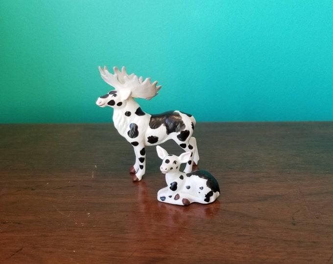 Featured listing image: Porcelain Piebald Moose Family Figurines
