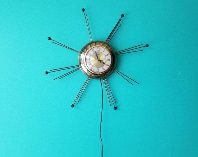 United Midcentury Modern Starburst Wall Clock
