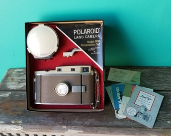 The 800 Polaroid Land Camera With Complete Presentation Kit