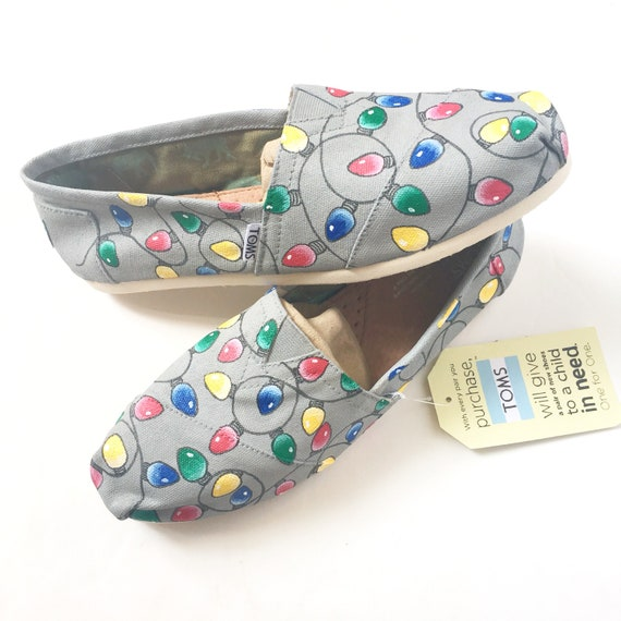 9a18b038a53 a pair of silver holiday womens classic toms slippers with every ...
